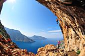 Alex Honnold climbing a very steep limestone cave in the Greek Islands