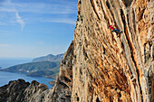 Alex Lowther climbs steep limestone route