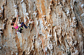 Stacey Michele climbs a limestone route on the Greek Islands
