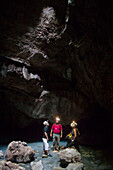 Four people exploring a cave in Tabasco,  Mexico.