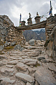 Gateway chortens to Naar Phu Valley, with khata and Buddhist prayer flag Lungta, offering. Manang, Nepal.