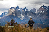 TORRES DEL PAINE NATIONAL PARK, PATAGONIA, CHILE. Hikers enjoy one of the best national parks in South America on a sunny day. With steep peaks full of hanging glaciers and glacial silt-filled lakes, Torres del Paine is one of the greatest attractions on