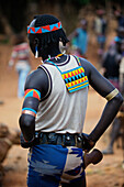 Men of the Banna tribe take a lot of care about there looks, especially when it is a market day, they dress up as the best. They wear a very tight and short mini skirt, with a leather belt,lots of beads and love bright colours. They always carry there hea