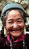 Old woman with a lovely smile without any teeth.   Ladakh, India, 2007.