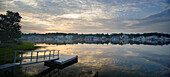 ROWAYTON, CT - JUNE 13: Morning clouds reflect in Rowayton Harbor as the sun just crests the horizon. Rowayton, a waterfront community of Norwalk, CT, is home to many sailors and fishermen and is about 45 miles up Long Island Sound from New York City.