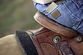 Texas saddle and wrangler jeans.