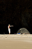 Alicia Ritter doing yoga while camping on a secluded beach in Ecola State Park along the Oregon Coast. Cannon Beach, OR