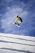 Toronto , ON -  March 11 : A freestyle snowboarder gets big air as he grabs his board.  Photo by Paul Giamou / Aurora Photos