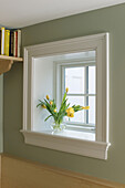 A vase filled with yellow tulips sits on a windowsill in a home in Rhode Island. Tom Hopkins/Aurora