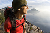 Young man hiking at Crater Lake National Park, Oregon.  releasecode: 050.jpg