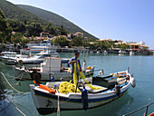 A man on a boat in the small village of Vassiliki on the Island of Lefkas in Greece.