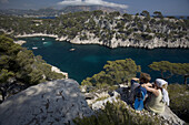 Matt Haine and Kelly Williams stop to take in the view before hiking down to the warm Mediterranean water of Port Miou, the Calanques near the town of Cassis, France. releaecode: ab0173, ab0174