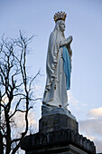 Statue in front of the Basilica of the Rosary at the site of the grotto where a farm girl saw a vision of the Virgin Mary, Lourdes, France. This spot is one of the top pilgrimage destinations in the world for Christian faiths.