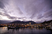 A night view of Cape Town harbor, the Victoria and Alfred Waterfront and Table Mountain, Cape Town, South Africa. Photo by Jonathan Kingston/Aurora