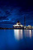 PUTRAJAYA, MALAYSIA, JUNE 17, 2007: Putra Mosque, also known as the state mosque, just after sunset. photo by Ian Shive/Aurora