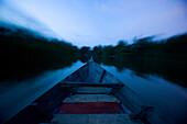 KUALA SELANGOR, MALAYSIA - JUNE 18, 2007: A wood boat moves through the Selangor River towards fireflies or kelip-kelip. photo by Ian Shive/Aurora
