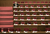 A delegate snaps a photo from his desk in the Great Hall of the People during a session of the National People's Congress, China's Parliament.