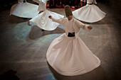 Istanbul, Turkey - January, 2008: The brotherhood of followers of Rumi known as Mevlevi or Whirling Dervishes perform their distinctive religious ceremony in Istanbul, Turkey. Rumi is famous for his poetry and religious writing and lived in the 13th centu