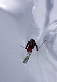 A skier catches air off a cornice at Alta Ski Area near Salt Lake City, UT