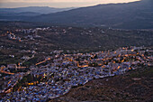 The town of Chefchaouen, Morocco, at the base of the Rif Mountains, glistens at  twilight on October 28, 2007.