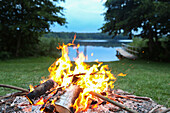 Campfire near a lake, Schorfheide-Chorin Biosphere Reserve, Neudorf, Friedenfelde, Uckermark, Brandenburg, Germany