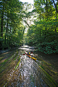 Exploring the river Wuerm in a kayak, near Munich, Bavaria, Germany