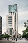 New modern highrise building next to Emperor Wilhelm Memorial Church, Berlin, Germany