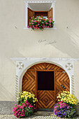 Close-up of a Grisons house with flower tubs, S-chanf, Upper Engadin, Canton of Graubuenden, Switzerland