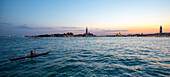 Paddler after sunset on Canal Grande, Venice, Italy