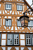 Maulaff bar sign lamp and timber frame building in the old town, Aschaffenburg, Franconia, Bavaria, Germany
