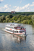 Sightseeing excursion boat Undine on the Main river and Maria im Weingarten pilgrimage church, Volkach, Franconia, Bavaria, Germany