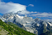 Clouds over Mont Blanc, Mont Maudit and Mont Blanc du Tacul, Lac d'Arpy, Graian Alps range, valley of Aosta, Aosta, Italy