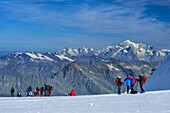 Several groups of persons standing on glacier of Gran Paradiso, Gran Paradiso, Gran Paradiso Nationalpark, Graian Alps range, valley of Aosta, Aosta, Italy