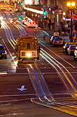 Street scene at night with historic San Francisco street car, San Francisco, California, United States of America, North America