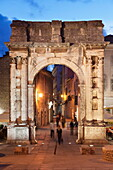Illuminated Roman triumphal arch, Arch of Sergil, in the Old Town at night, Pula, Istria, Croatia, Europe