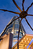 Low angle view at dusk of Mori Tower and Maman Spider sculpture, Roppongi Hills, Minato Wad, Tokyo, Honshu, Japan, Asia