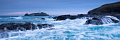 Waves crash around the rocks in winter near Godrevy Lighthouse, Cornwall, England, United Kingdom, Europe
