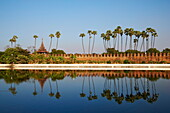 Palm trees reflected in the moat of the fortified palace, Mandalay Palace, Mandalay, Myanmar (Burma), Asia
