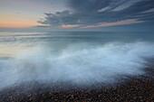 A study at twilight of the shingle beach at Weybourne, Norfolk, England, United Kingdom, Europe