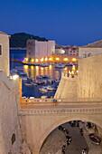 Harbour and Old City Walls at dusk, UNESCO World Heritage Site, Dubrovnik, Dalmatia, Croatia, Europe