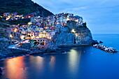 The Cinque Terre village of Manarola at dusk, Cinque Terre, UNESCO World Heritage Site, Liguria, Italy, Mediterranean, Europe