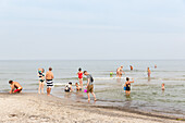Vacationers bathing in Baltic Sea, Marielyst, Falster, Denmark