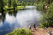 Two persons at Oulankajoki River, Oulanka National Park, Northern Ostrobothnia, Finland