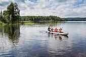 Children in a canoe on lake Vaermeln, Vaermland, Sweden