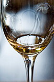 Tears of wine on glass of white wine