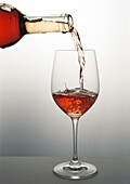 Pouring a glass of rosŽ wine