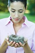 Woman holding nest