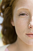 Young red-haired woman, close-up