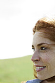 Woman outdoors, looking away, portrait