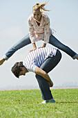 Mature couple playing leapfrog